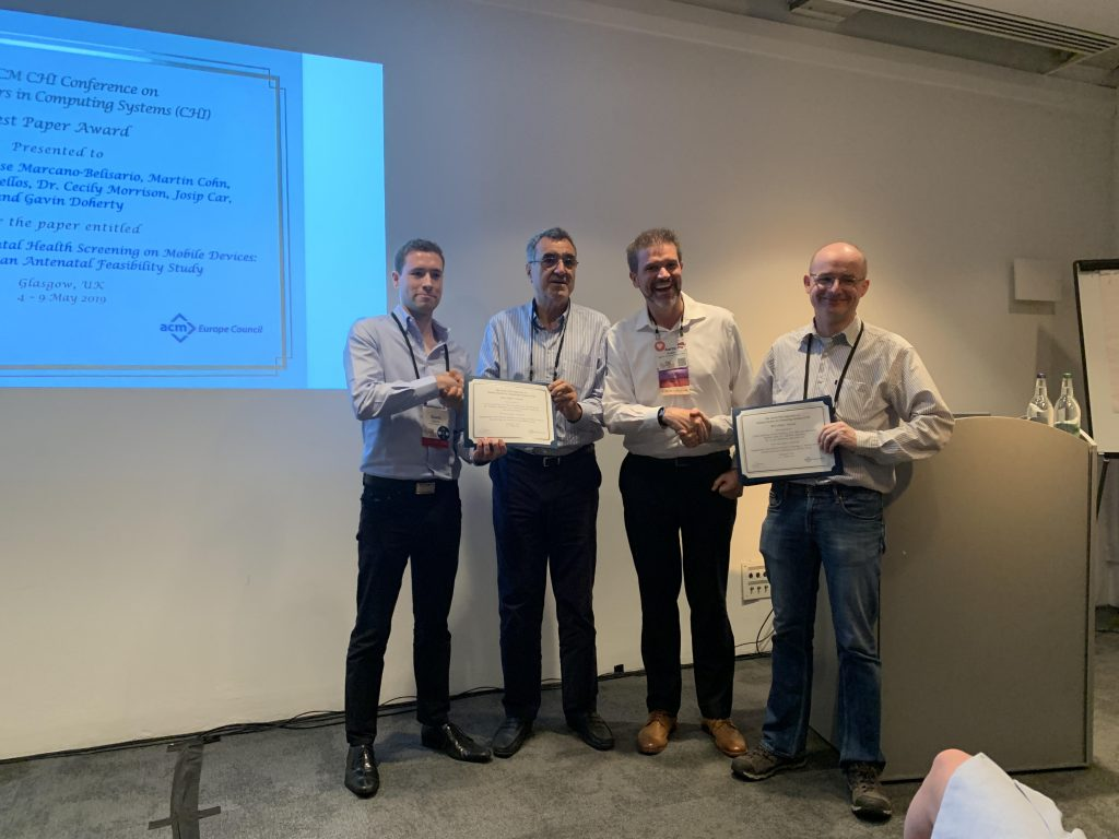 This photo shows the winners of the ACM Europe Council Best Paper Award receiving their award certificates, at the CHI 2019 conference.